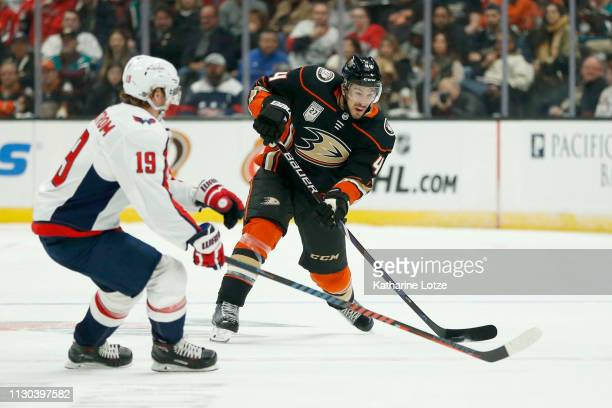 Michael Del Zotto of the Anaheim Ducks passes as Nicklas Backstrom of the Washington Capitals looks to block during the first period at Honda Center...