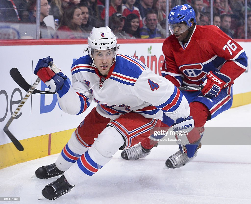 Michael Del Zotto #4 of the New York Rangers and P.K. Subban #76 of the Montreal Canadiens chase after the puck during the NHL game on March 30, 2013 at the Bell Centre in Montreal, Quebec, Canada.