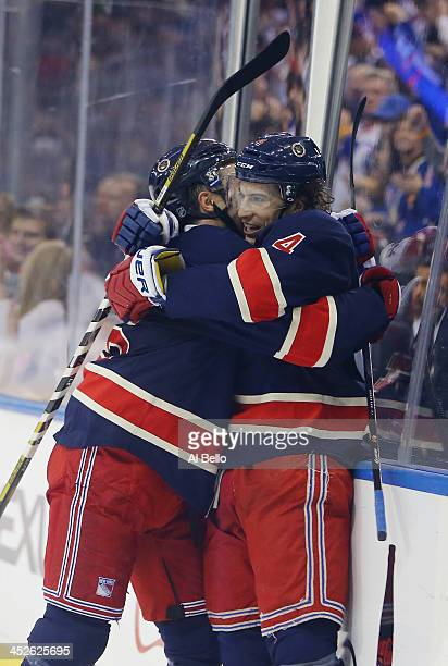 Michael Del Zotto of the New York Rangers celebrates his second period goal with Derick Brassard during their game against the Vancouver Canucks at...