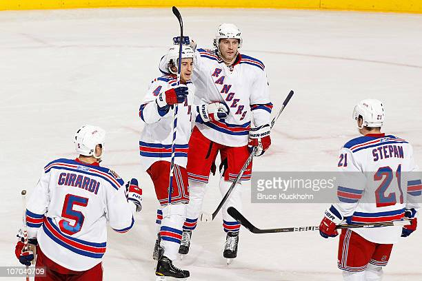 Michael Del Zotto of the New York Rangers celebrates with his teammates after scoring the second goal of the game against the Minnesota Wild at Xcel...
