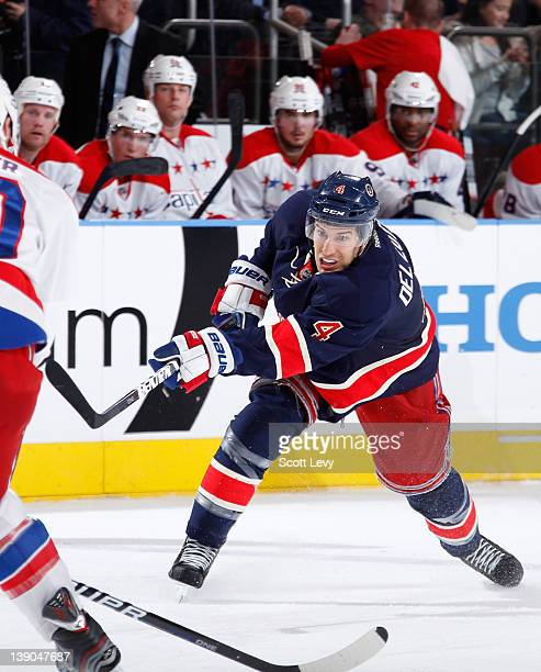 Michael Del Zotto of the New York Rangers shoots the puck against the Washington Capitals at Madison Square Garden on February 12 2012 in New York...