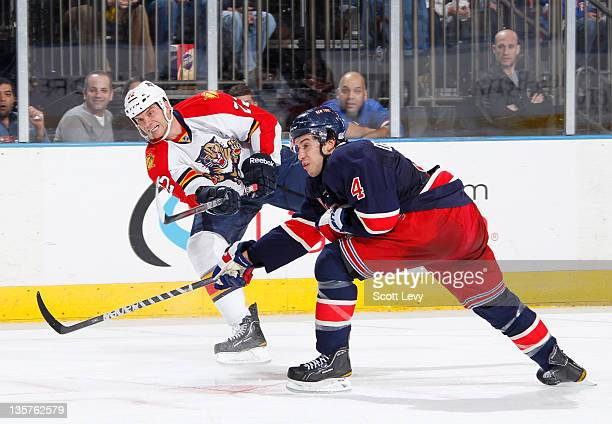 Michael Del Zotto of the New York Rangers skates against Matt Bradley of the Florida Panthers at Madison Square Garden on December 11 2011 in New...