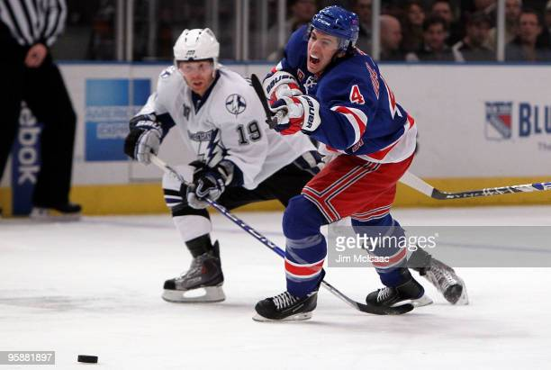Michael Del Zotto of the New York Rangers skates against Stephane Veilleux of the Tampa Bay Lightning on January 19 2010 at Madison Square Garden in...