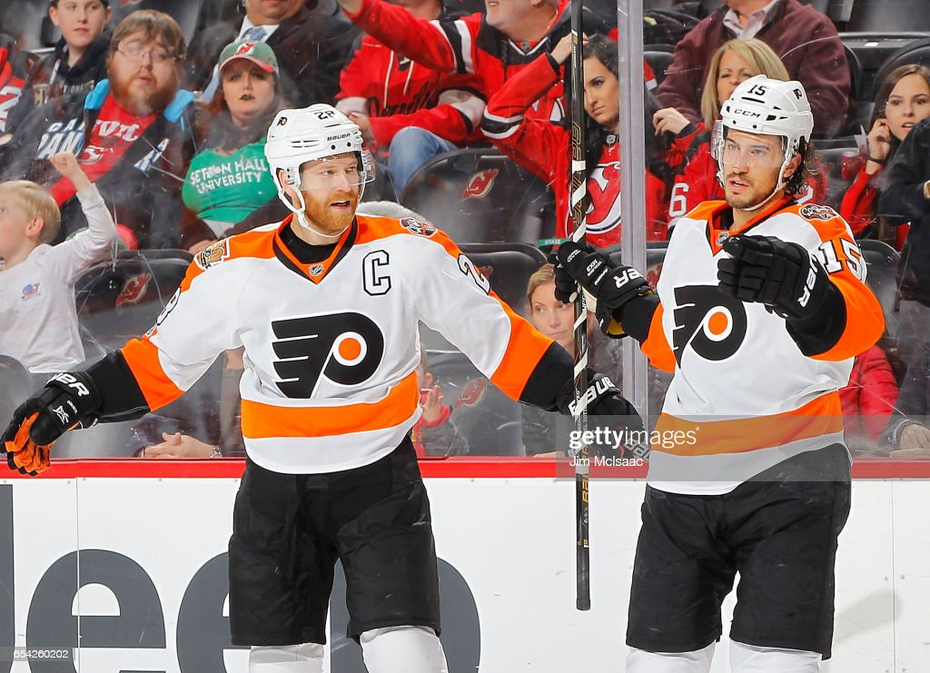 Michael Del Zotto #15 of the Philadelphia Flyers celebrates his first period goal against the New Jersey Devils with teammate Claude Giroux #28 on March 16, 2017 at Prudential Center in Newark, New Jersey.