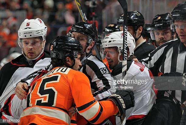 Michael Del Zotto of the Philadelphia Flyers is involved in a scrum with Jacob Josefson and Adam Larsson of the New Jersey Devils on February 13 2016...