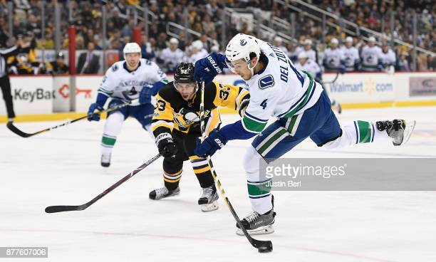 Michael Del Zotto of the Vancouver Canucks attempts a shot on goal in the first period during the game against the Pittsburgh Penguins at PPG PAINTS...
