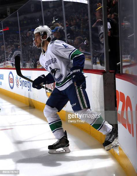 Michael Del Zotto of the Vancouver Canucks hits the ice prior to puck drop against the Winnipeg Jets at the Bell MTS Place on December 11 2017 in...
