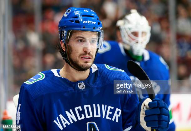 Michael Del Zotto of the Vancouver Canucks looks on from the bench during their NHL game against the Winnipeg Jets at Rogers Arena October 12 2017 in...