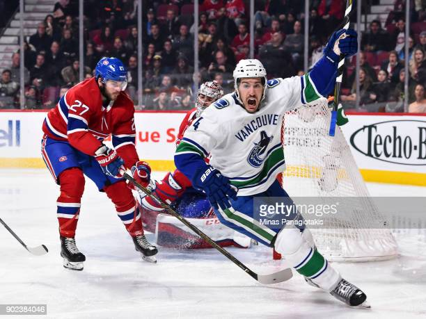 Michael Del Zotto of the Vancouver Canucks reacts after scoring a goal in the third period against the Montreal Canadiens during the NHL game at the...