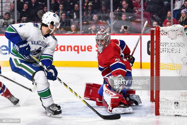 Michael Del Zotto of the Vancouver Canucks scores a third period goal on goaltender Carey Price of the Montreal Canadiens during the NHL game at the...