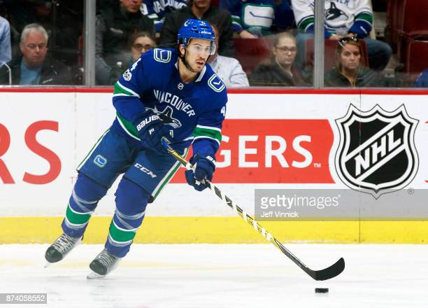Michael Del Zotto of the Vancouver Canucks skates up ice with the puck during their NHL game against the Dallas Stars at Rogers Arena October 30 2017...