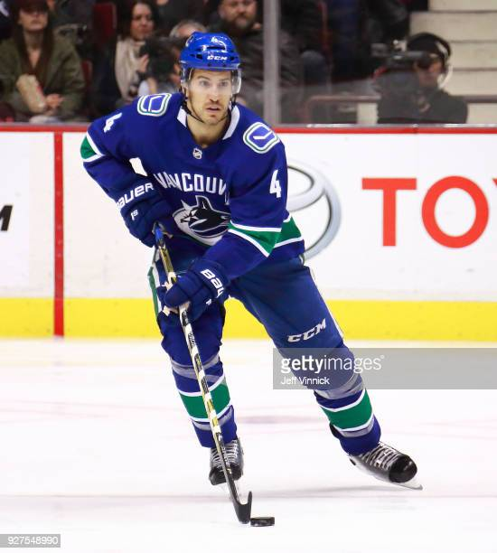 Michael Del Zotto of the Vancouver Canucks skates up ice with the puck during their NHL game against the Florida Panthers at Rogers Arena February 14...