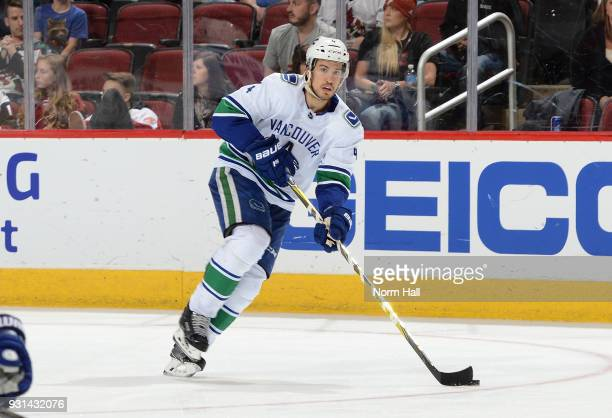 Michael Del Zotto of the Vancouver Canucks skates with the puck against the Arizona Coyotes at Gila River Arena on March 11 2018 in Glendale Arizona