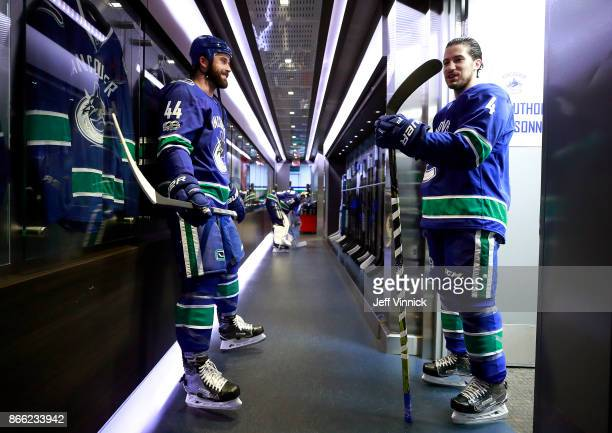 Michael Del Zotto of the Vancouver Canucks talks to teammate Erik Gudbranson during their NHL game against the Winnipeg Jets at Rogers Arena October...