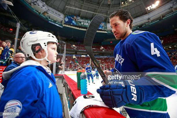 Michael Del Zotto of the Vancouver Canucks talks with Toyota trainer Adrian Scott before their NHL game against the Los Angeles Kings at Rogers Arena...
