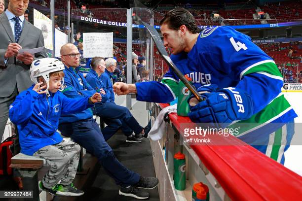 Michael Del Zotto of the Vancouver Canucks talks with Toyota Trainer Denver Jory during warmup their NHL game against the Minnesota Wild at Rogers...