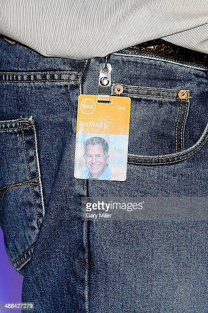 Michael Dell wears his company ID badge as he speaks to team members from around the world at the company's 30th birthday town hall celebration at...