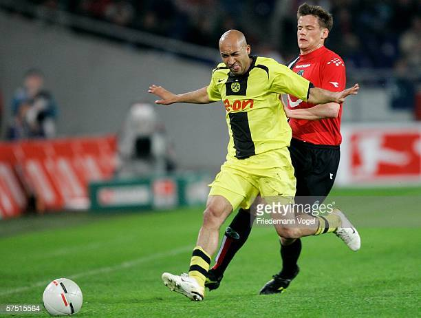 Michael Delura of Hanover challenges for the ball with Dede of Dortmund during the Bundesliga match between Hanover 96 and Borussia Dortmund at the...