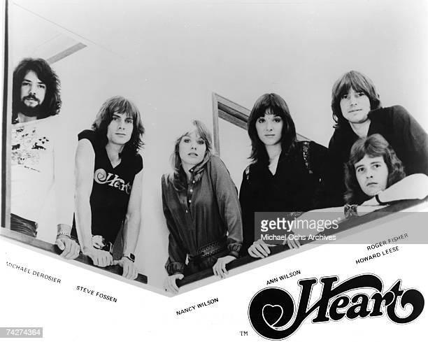 "Michael Derosier, Steve Fossen, Nancy Wilson, Ann Wilson, Roger Fisher, Howard Leese of the rock band ""Heart"" pose for a portrait in circa 1975."