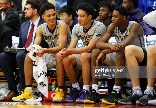 Michael Devoe Andrew Nembhard and RJ Barrett of Montverde Academy look on from the bench during a game against Mater Dei High School during the 2018...