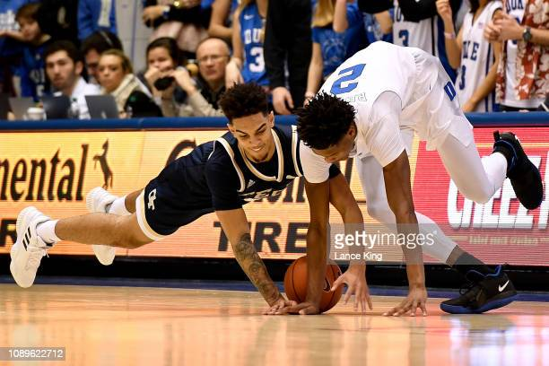 Michael Devoe of the Georgia Tech Yellow Jackets and Cam Reddish of the Duke Blue Devils battle for a loose ball in the first half at Cameron Indoor...