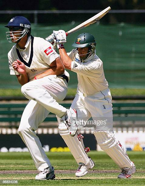 Michael Di Venuto of the Tigers square drives for four during day one of the Pura Cup match between the Victorian Bushrangers and the Tasmanian...