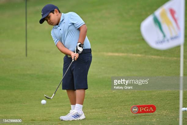 Michael Diaz attempts a chip during the 2021 Drive, Chip and Putt Regional Qualifier at TPC Scottsdale on September 26, 2021 in Scottsdale, Arizona.