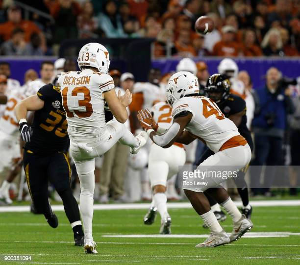 Michael Dickson of the Texas Longhorns punts the ball against the Missouri Tigers during the Academy Sports Outdoors Bowl at NRG Stadium on December...