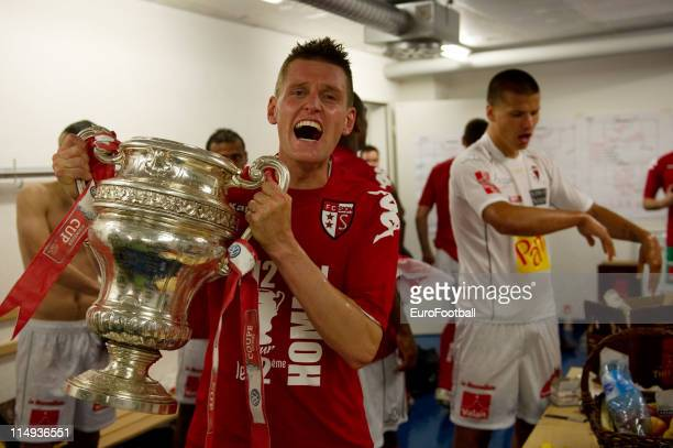 Michael Dingsdag of FC Sion celebrates with the trophy in the dressing room after the Swiss Cup final match between Neuchatel Xamax FC and FC Sion at...