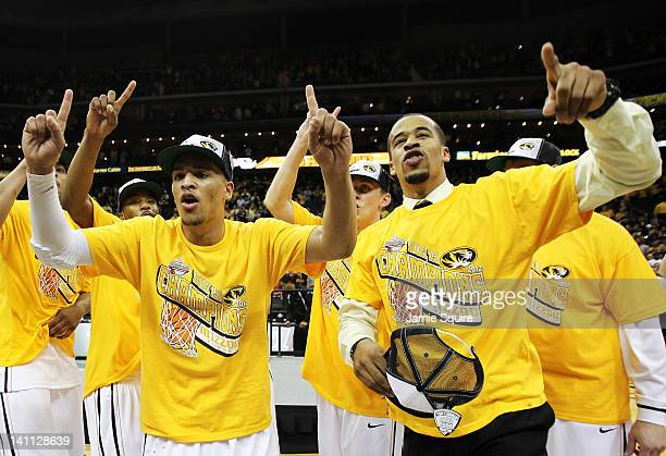 Michael Dixon and Laurence Bowers of the Missouri Tigers celebrates with teammates after they defeated the Baylor Bears 90 to 75 to win the...