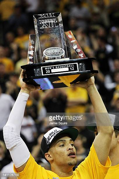 Michael Dixon of the Missouri Tigers celebrates with the trophy after they defeated the Baylor Bears 90 to 75 to win the championship game of the...