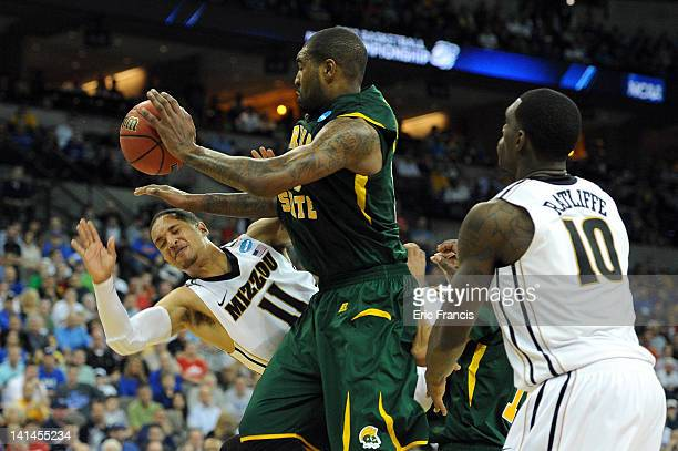 Michael Dixon of the Missouri Tigers loses the ball as he drives against Kyle O'Quinn of the Norfolk State Spartans during the second round of the...