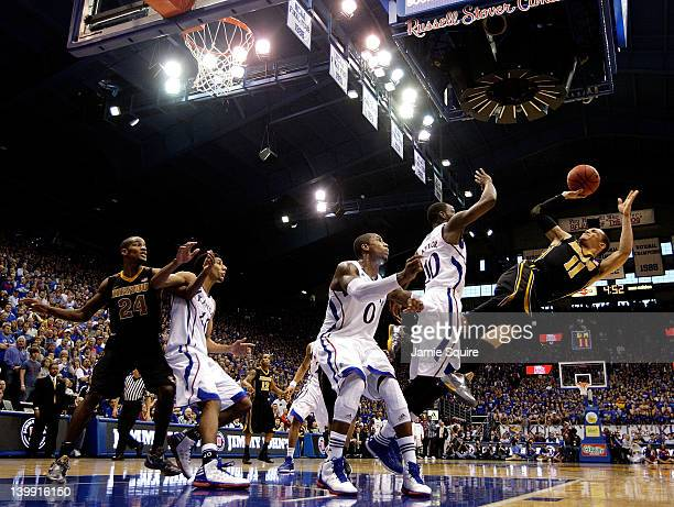 Michael Dixon of the Missouri Tigers shoots during the game against the Kansas Jayhawks on February 25 2012 at Allen Fieldhouse in Lawrence Kansas