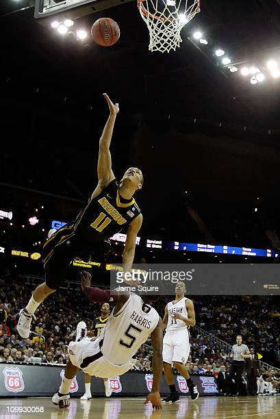 Michael Dixon of the Missouri Tigers throws up a shot against Dash Harris of the Texas AM Aggies during their quarterfinal game in the 2011 Phillips...