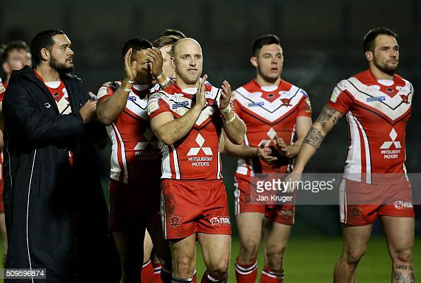 Michael Dobson of Salford Red Devils applauds the fans with team mates after the final whistle during the First Utility Super League match between...