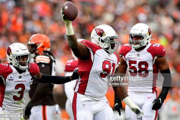 Michael Dogbe of the Arizona Cardinals recovers a fumble during a game against the Cleveland Browns at FirstEnergy Stadium on October 17, 2021 in...