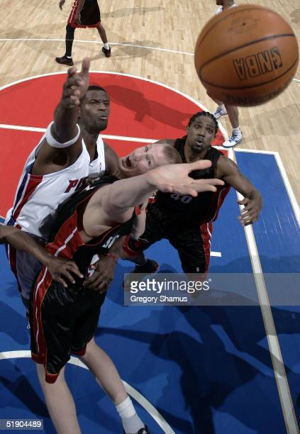 Michael Doleac of the Miami Heat jumps for a rebound against Antonio McDyess of the Detroit Pistons at the Palace of Auburn Hills on December 30,...