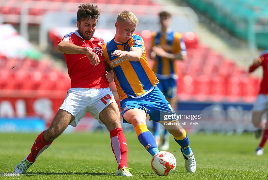 Michael Doughty of Swindon Town and Jack Grimmer of Shrewsbury Town during the Sky Bet League One match between Swindon Town and Shrewsbury Town at County Ground on May 8, 2016 in Swindon, England.