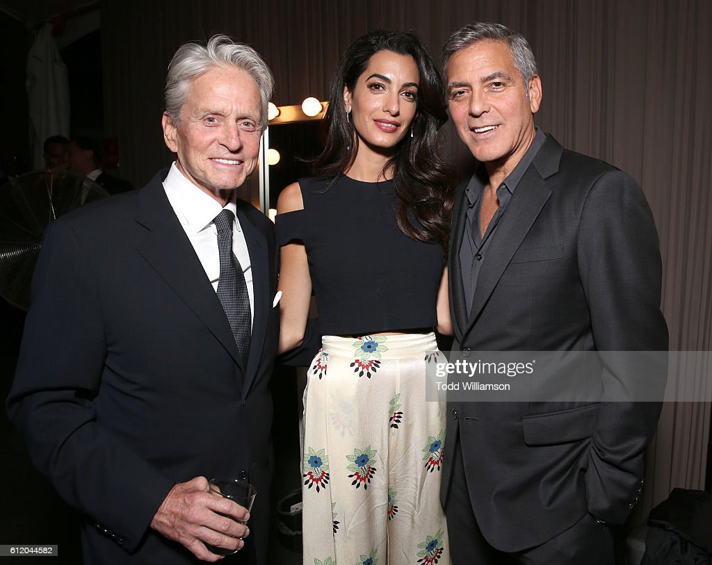 Michael Douglas, Amal Clooney and George Clooney attend the MPTF 95th anniversary celebration with 'Hollywood's Night Under The Stars' at MPTF Wasserman Campus on October 1, 2016 in Los Angeles, California.