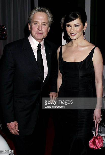Michael Douglas and Catherine ZetaJones attend NBC's Access Hollywood Golden Globe Party January 25 2004 in Hollywood California