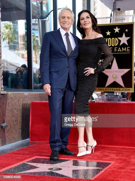 Michael Douglas and Catherine ZetaJones pose at the Michael Douglas Star On The Hollywood Walk Of Fame ceremony on November 6 2018 in Hollywood...