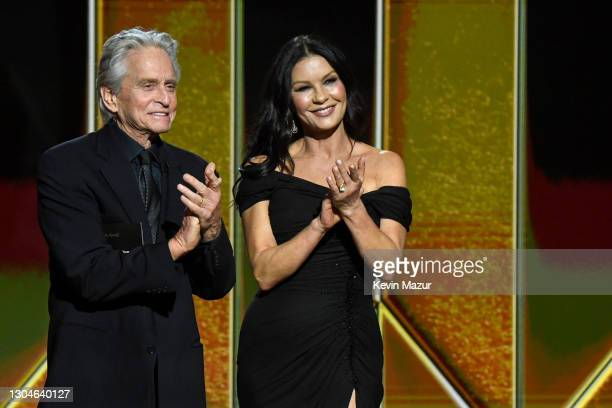 Michael Douglas and Catherine Zeta-Jones present the award for Best Picture Drama onstage during the 78th Annual Golden Globe® Awards at The Rainbow...