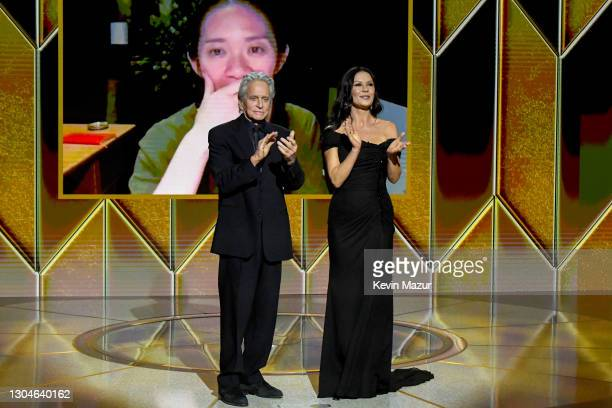 Michael Douglas and Catherine Zeta-Jones present the award for Best Picture Drama to Chloé Zhao for Nomadland via livestream during the 78th Annual...