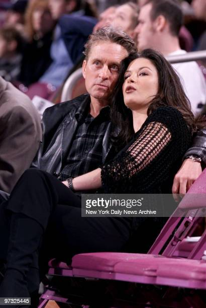 Michael Douglas and Catherine ZetaJones watch game between the New York Knicks and Indiana Pacers at Madison Square Garden The Knicks defeated the...