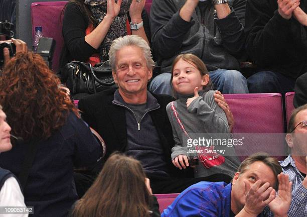 Michael Douglas and daughter Carys Zeta Douglas attend the Pittsburgh Penguins vs New York Rangers game at Madison Square Garden on February 13 2011...