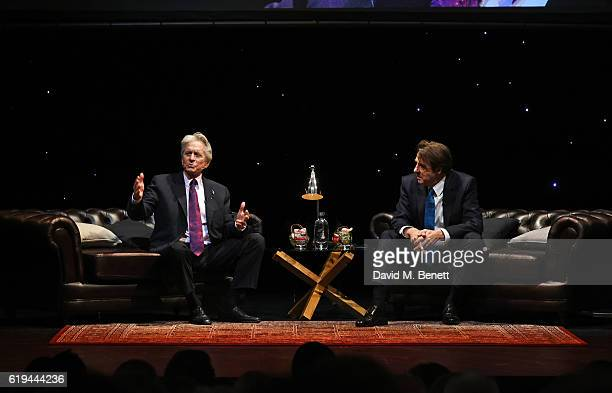 Michael Douglas and Jonathan Ross speak during 'An Evening With Michael Douglas' in conversation with Jonathan Ross at Theatre Royal Drury Lane on...