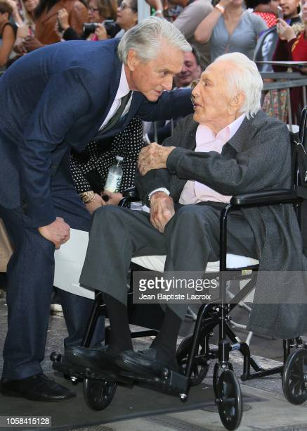 Michael Douglas and Kirk Douglas pose at the Michael Douglas Star On The Hollywood Walk Of Fame ceremony on November 6 2018 in Hollywood California
