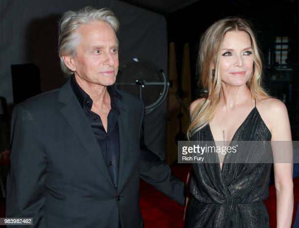 Michael Douglas and Michelle Pfeiffer attend the premiere of Disney And Marvel's 'AntMan And The Wasp' on June 25 2018 in Hollywood California