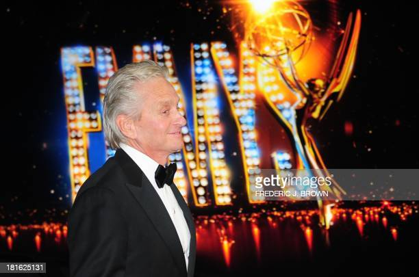 Michael Douglas arrives in the press room after winning Best Actor in a Miniseries/Movie for playing Liberace in 'Behind the Candelabra' on September...