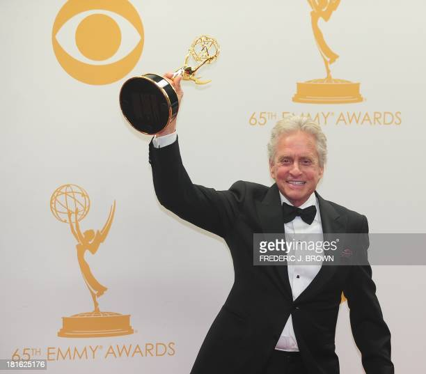 Michael Douglas celebrates winning Best Actor in a Miniseries/Movie for playing Liberace in 'Behind the Candelabra' on September 22 2013 in the press...